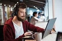 Man listening to a webinar on a laptop